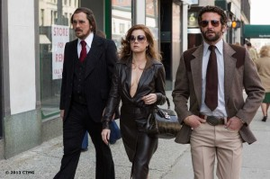 Christian Bale, Amy Adams and Bradley Cooper in American Hustle.