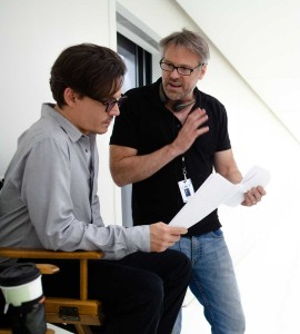 Johnny Depp (left) and director Wally Pfister on the set of Alcon Entertainment's sci-fi thriller Transcendence, a Warner Bros. Pictures release.