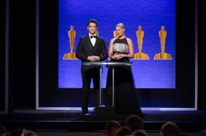 Hosts Miles Teller and Margot Robbie.