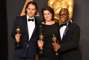 Producers Jeremy Kleiner, Adele Romanski, and director Barry Jenkins, Oscar 2017 winners for Best Picture for Moonlight, pose in the press room during the 89th Academy Awards.