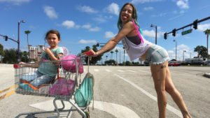 Brooklynn Prince in cart & Bria Vinaite, by Marc Schmidt, Courtesy A24