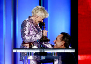 "Richard E. Grant (R) accepts Best Supporting Male for ""Can You Ever Forgive Me?"" from Glenn Close onstage during the 2019 Film Independent Spirit Awards (Photo by Tommaso Boddi/Getty Images)"