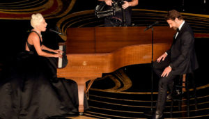 Lady Gaga and Bradley cooper performing musically at the 91st Academy Awards