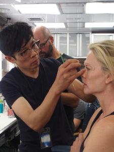 Kazu Hiro applying prosthetics on Charlize Theron