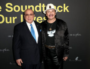 Clive Davis & Carlos Santana at a Film Premiere