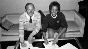 Clive Davis signing a teenaged Whitney Houston to a record contract