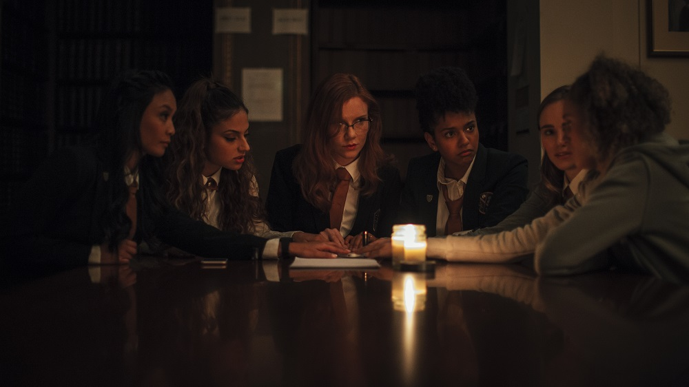 [L-R] Stephanie Sy as Yvonne, Inanna Sarkis as Alice, Madisen Beaty as Bethany, Djouliet Amara as Rosalind, Suki Waterhouse as Camille, and Ella-Rae Smith as Helina in Seance